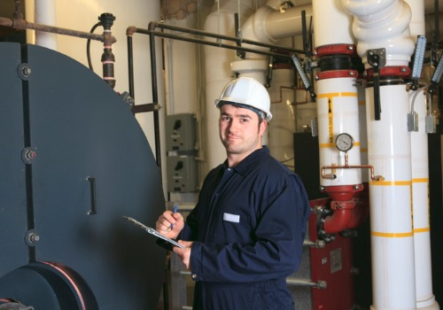 A technician inspecting a boiler before Boiler Repair in Illinois
