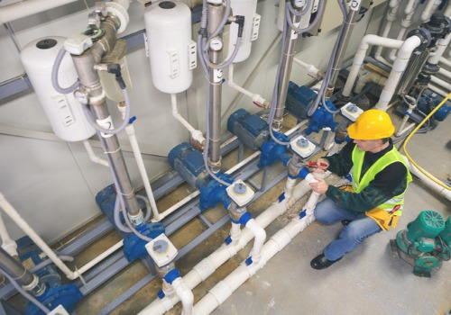 A repairman in a boiler room preparing for Boiler Repair in Illinois