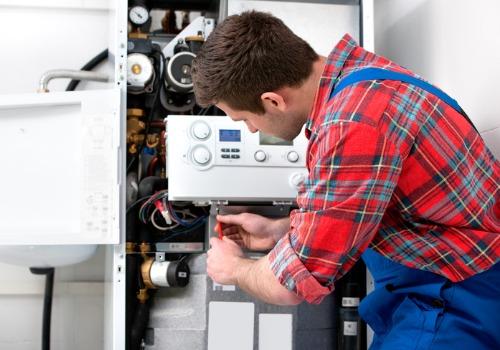 A technician repairing a boiler, as a part of IL Boiler Services