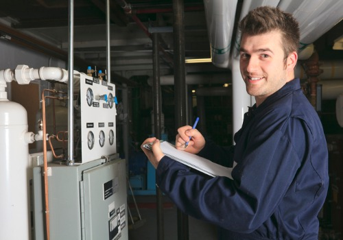 Technician Smiling as Inspecting a Boiler for Repair in IL