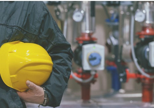 Mechanic Holding Yellow Hard Hat After a Commercial Boiler Inspection in Illinois