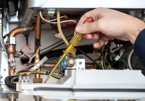Technician Repairing the Inside of Burnham Boilers in Illinois