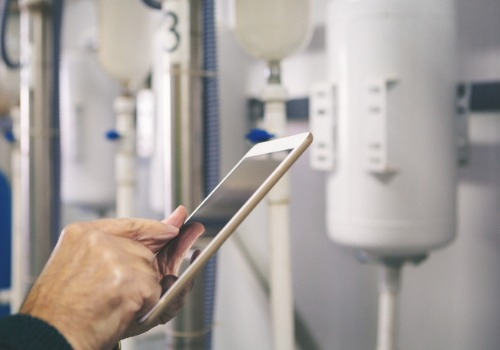 Technician Inspecting iPad After Performing Industrial Boiler Services in Illinois