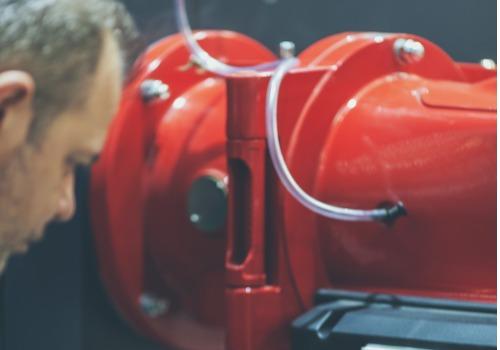 Commercial Heating Contractors Looking Over an Industrial Boiler